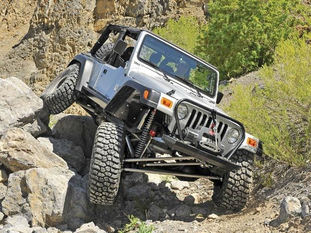 Off-Road Vehicle Driving In Mountains - off-road parts store st. george