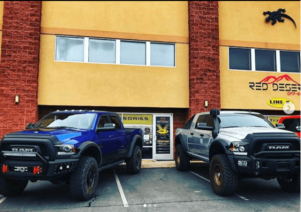 Vehicles Parked Outside Red Desert Shop - off-road accessories store st. george