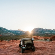 Jeep parked in front of a sunset - St. George off-road accessory store