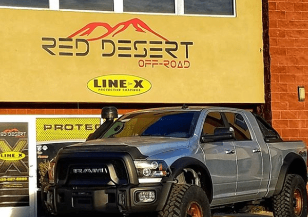 Grey Truck Parked Outside Red Desert Off-Road Shop - off-road truck accessories st. george